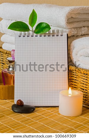 Spa with towels with a candle and pad