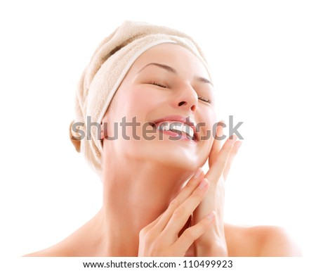 Spa Woman. Beautiful Girl After Bath Touching Her Face. Perfect Skin. Skincare. Young Skin. Girl Pleased with the Results from the Spa Treatments
