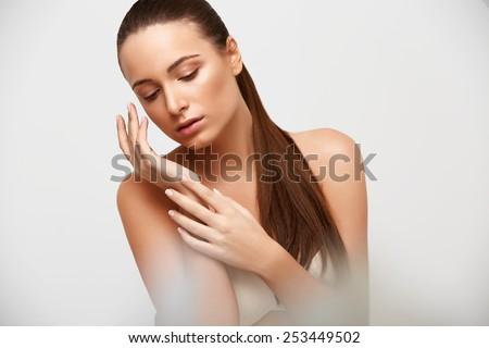 Spa Woman. Beautiful Girl Touching Her Face. Perfect Skin. Skincare. Young Skin #253449502