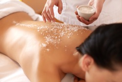 Spa Woman. Brunette Getting a Salt Scrub Beauty Treatment in the Health Spa. Body Scrub.