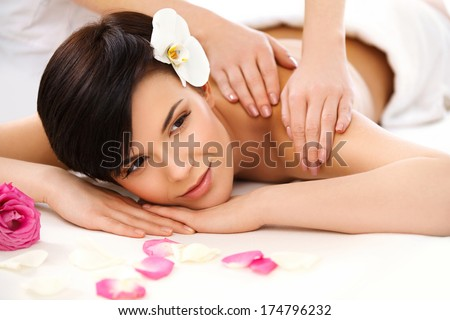 Spa Woman. Close-up of a Beautiful Woman Getting Spa Treatment. Massage