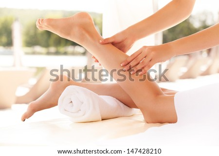 Spa Woman. Close-up of a young woman getting spa treatment. Foot massage