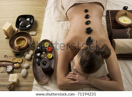 Spa Woman.Hot Stones Massage.Beauty salon