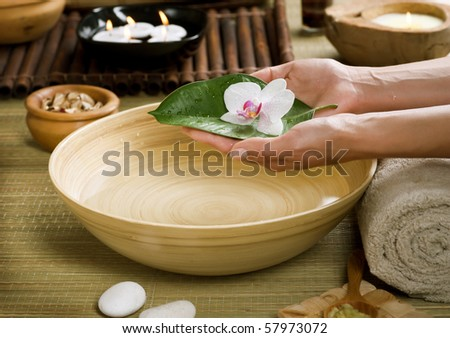 Spa.Woman's Hands with flower.Luxury Manicure concept
