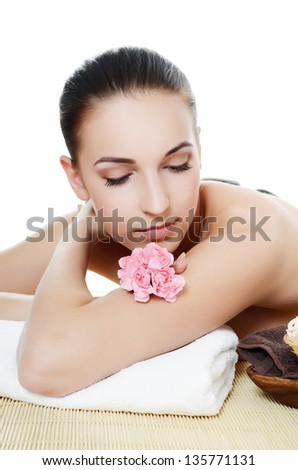 Spa Woman. Stone Massage isolated on white. Skincare