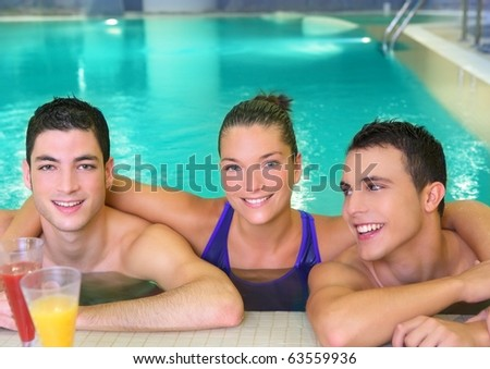 spa young friends group smiling in turquoise pool water