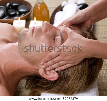 Spa.Young Man getting Face Massage.