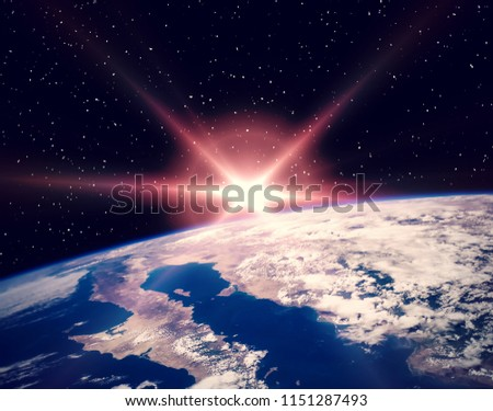 Space and sunrise. The elements of this image furnished by NASA.