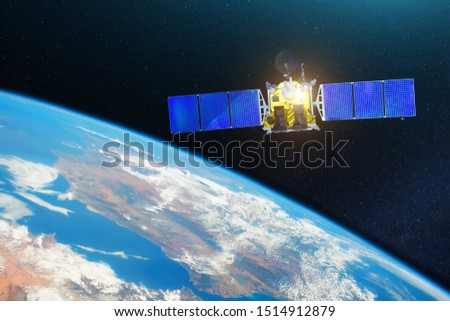 Space communications satellite in orbit around the Earth. Elements of this image furnished by NASA.