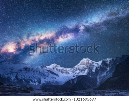 Space. Milky Way and mountains. Fantastic view with mountains and starry sky at night in Nepal. Mountain valley and sky with stars. Beautiful Himalayas. Night landscape with bright milky way. Galaxy Foto d'archivio ©