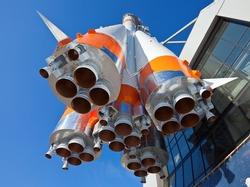 Space rocket against blue sky