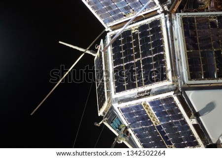 Space Satellite. Space satellite (magion) covered with solar panels. #1342502264