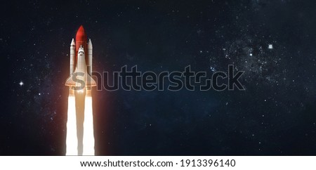 Space shuttle in outer space on dark background. Rocket with astronauts. Elements of this image furnished by NASA