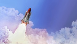 Space shuttle in the blue sky with cloud. Launch of spaceship. Space wallpaper. Elements of this image furnished by NASA