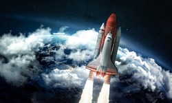 Space shuttle in the space near Earth. Clouds and sky on background. Atmosphere. Elements of this image furnished by NASA