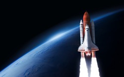 Space shuttle launch in the open space from the Earth