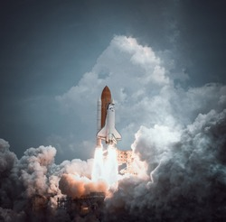 Space shuttle launches with dramatic smoke. Elements of this image furnished by NASA