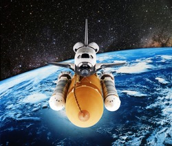 Space Shuttle orbiting the earth. Elements of this image furnished by NASA.