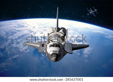 Space Shuttle orbiting the earth. Elements of this image furnished by NASA. #285637001