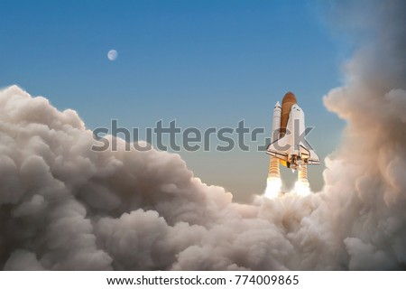Space Shuttle starts its mission and takes off into the sky. Rocket with clouds of smoke flying into space