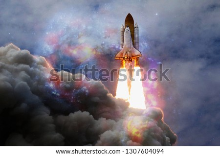 Space shuttle taking off on a mission. Deep space. Beauty of endless universe. Elements of this image furnished by NASA #1307604094