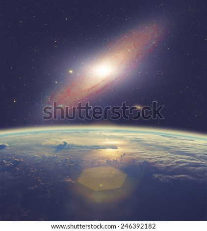 Space sunrise with Andromeda galaxy. Elements of this image furnished by NASA. #246392182