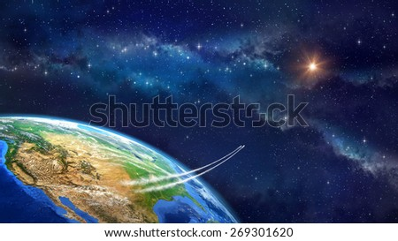 Space travel. Very high definition picture of planet earth in outer space. Spacecrafts lifting off from USA soil. Elements of this image furnished by NASA