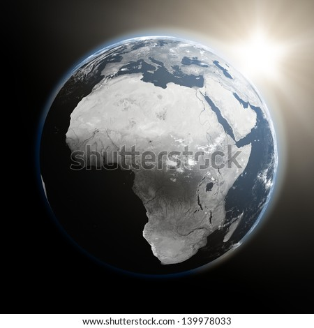 Space view of the sun rising over Africa on blue planet Earth. Elements of this image furnished by NASA.