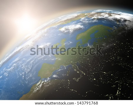 Space view of the sun rising over Europe on planet Earth. Elements of this image furnished by NASA.