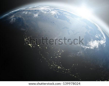 Space view of the sun rising over North America on blue planet Earth. Elements of this image furnished by NASA.