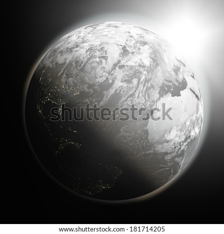 Space view of the sun rising over northern hemisphere on black planet Earth. Elements of this image furnished by NASA.
