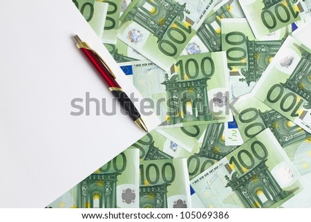space white paper in background with 100 euro banknotes