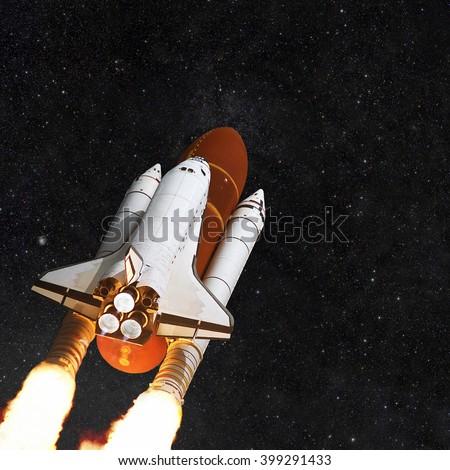 Spacecraft shuttle on the background star field