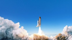 Spacecraft takes off into space. The rocket starts in the blue sky. Travel concept
