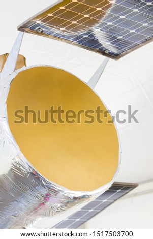 Spacecraft with solar panels. Model satellite for launching into space