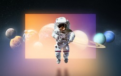 Spaceman floating at hte dark background with reflection. Solar system planets. Space art. Elements of this image furnished by NASA.