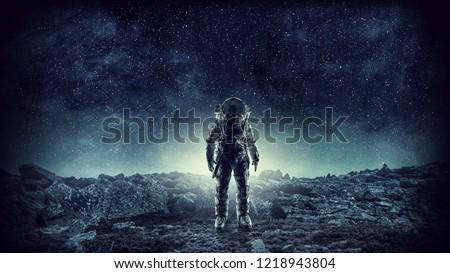 Spaceman landing planet. Mixed media