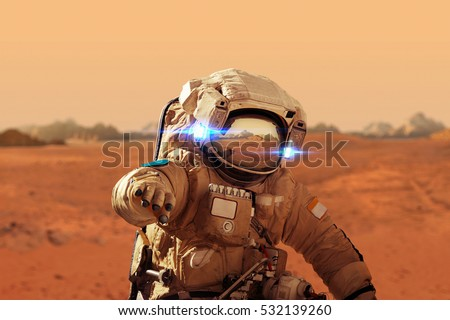 Shutterstock Spaceman walks on the red planet Mars. Space Mission. Astronaut travel in space