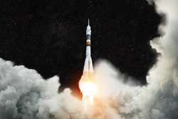 Spaceship launches into space. Rocket takes off against the background of the starry sky. Rocket liftoff.