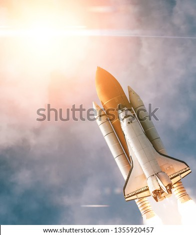 Spaceship Leaving Earth. Space craft taking off into deep space. Elements of this image furnished by NASA. #1355920457