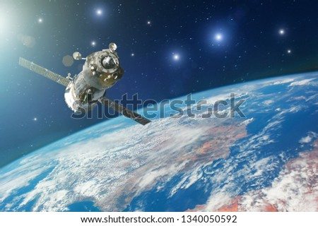 Spaceship piloted by astronauts in the orbit of planet Earth with bright stars. Elements of this image furnished by NASA