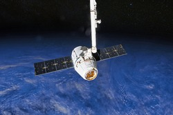 SpaceX Crew Dragon spacecraft docking to the International Space Station. Dragon is capable of carrying up to 7 passengers to and from Earth orbit, and beyond. Elements of this image furnished by NASA