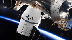 SpaceX Crew Dragon spacecraft is docked to the Space Station. Elements of this image furnished by NASA.