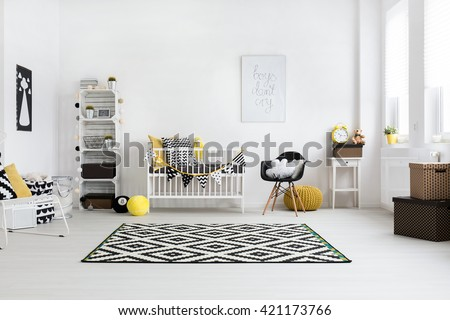 Spacious baby room with bright windows and scandinavian furniture