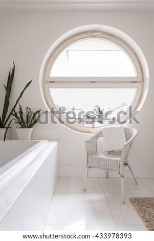 Beau Spacious Bathroom With White Tiling, Bathtub, Chair And Round Window  #433978393