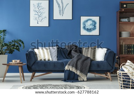 Spacious blue living room designed in old style - Shutterstock ID 627788162