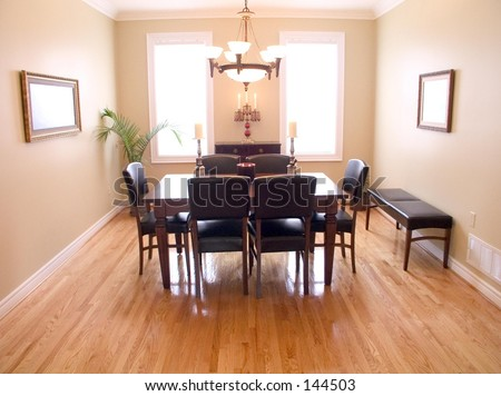 spacious dining room has dark wood table six chairs chandelier