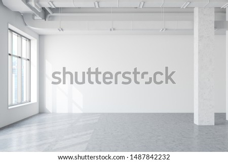 Spacious empty industrial style office interior with white walls, concrete floor, columns and windows with cityscape. 3d rendering mock up