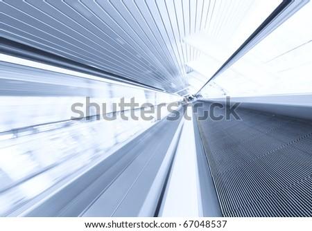 spacious gray escalator walkway - stock photo
