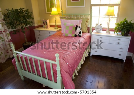 Spacious kids bedroom with bright colors.
